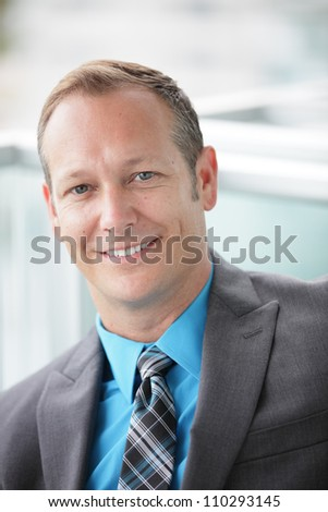 Stock image of a smiling businessman - stock photo