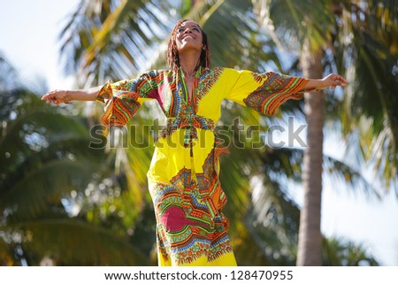 Stock image of a young African American woman outstretching her arms - stock photo