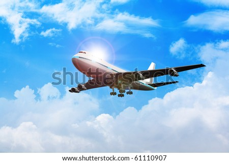 Stock image of an airplane flying on the sky