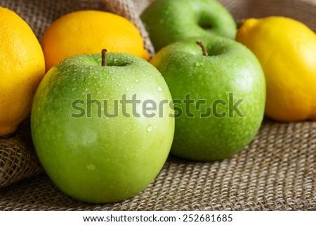 Stock image of apples and lemons freshly picked - stock photo