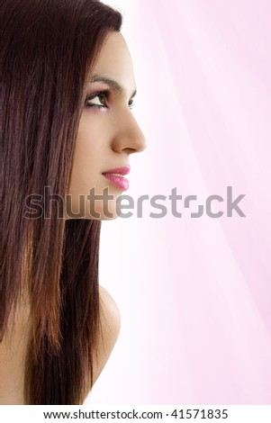 Stock image of beautiful woman over pink background - stock photo