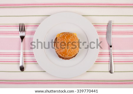 stock image of burger on blue plate. diet conceptual - stock photo