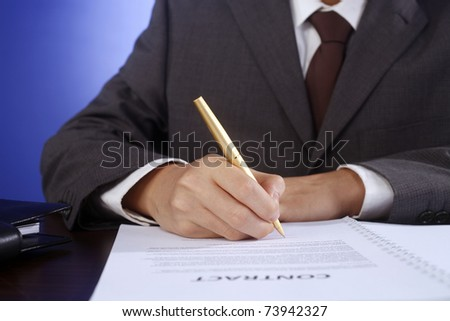 stock image of bussiness man signing contract