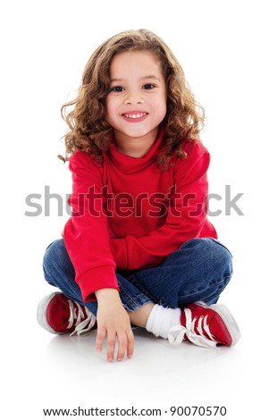 Stock image of cute little girl sitting and smiling, isolated on white with shadow on floor - stock photo