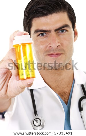 Stock image of doctor holding a bottle of prescription drugs - stock photo