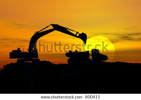 Stock image of earth mover trying to get a last load before the storm