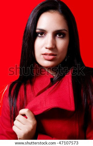 Stock image of fashion model with red coat over red background - stock photo