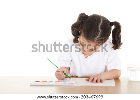 Stock image of female preschooler drawing with watercolors over white background - stock photo