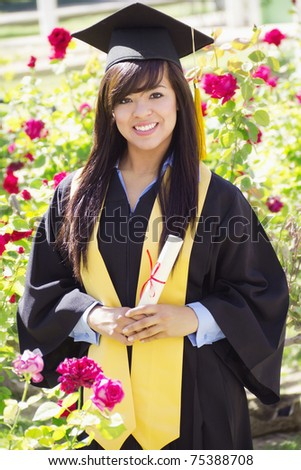 Stock image of happy female graduate, outdoor setting, - stock photo