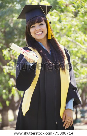 Stock image of happy female graduate, outdoor setting - stock photo