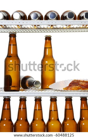 Stock image of interior of a refrigerator full of beers and a slice of pizza