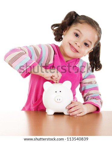 Stock image of little girl placing coin in piggy bank over white background - stock photo
