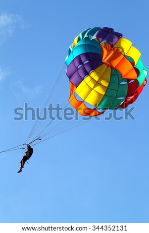 Stock image of parachuting over a sea, towing by a boat