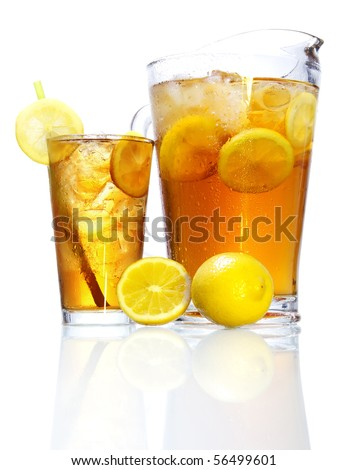 Stock image of pitcher and glass of Iced tea over white background with reflection on bottom, could be Long Island Iced Tea. Find more cocktail and prepared drinks images on my portfolio. - stock photo