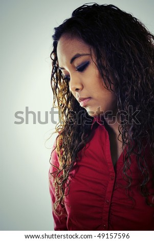 Stock image of sad young woman, also works great as a black and white image. - stock photo