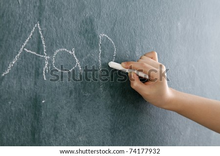 stock image of the little girl writting abc - stock photo