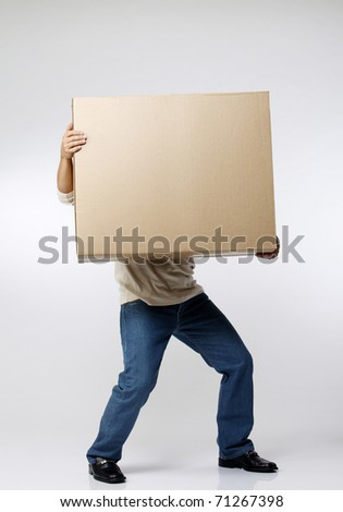 stock image of the man carrying paper box - stock photo