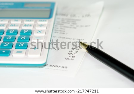 stock image of the receipt paper and calculator - stock photo