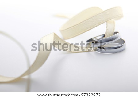 stock image of the rings and ribbon - stock photo