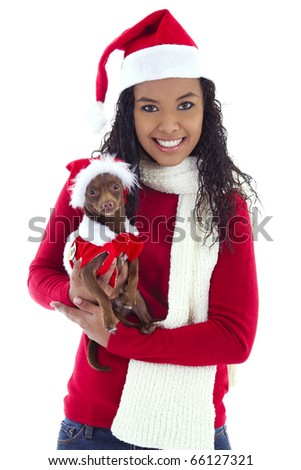 Stock image of woman holding pet Chihuahua, both wearing christmas costume