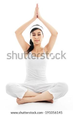 Stock image of woman meditating over white background - stock photo
