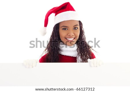 Stock image of woman wearing santa hat holding blank board with copy space