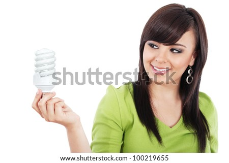 Stock image of young woman looking at compact fluorescent lightbulb isolated on white background - stock photo