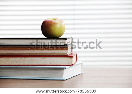 stock image stack of books near window