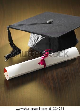 stock imageof Graduation cap and diploma - stock photo