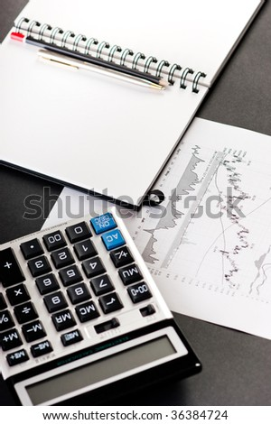 Stock index reports with calculator are ready for analyzing - stock photo