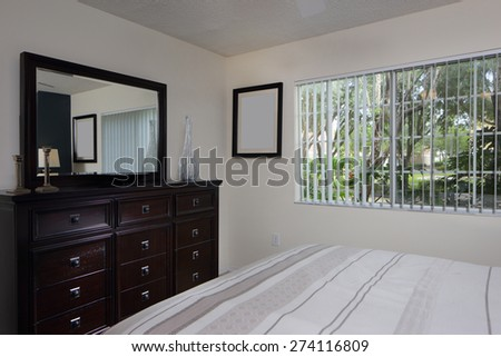Stock interior image of a bedroom with furniture and decor - stock photo