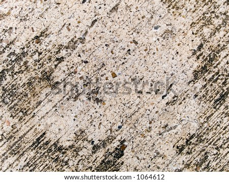 Stock macro photo of the texture of discolored concrete.  Useful as a layer mask or abstract background.