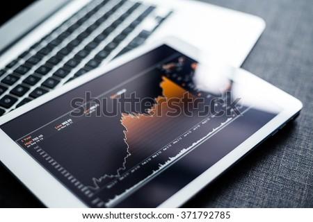 Stock market chart digital tablet - stock photo