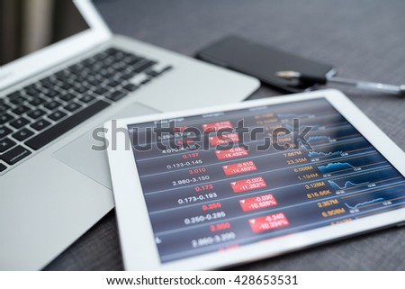 Stock market data application on a digital tablet - stock photo