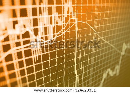 Stock market graph and bar chart price display. Data on live computer screen. Display of quotes pricing graph visualization. Abstract financial background trade on colorful computer monitor display. - stock photo