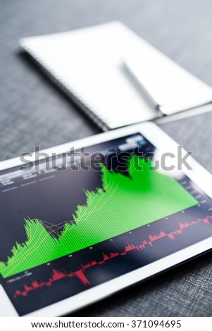 Stock market graph on tablet computer - stock photo