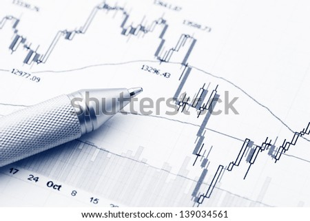 Stock market graph with pen - stock photo