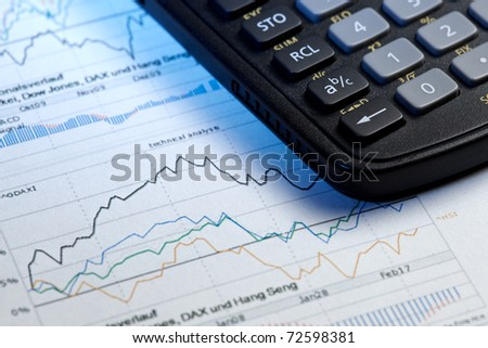stock market paperwork with calculator
