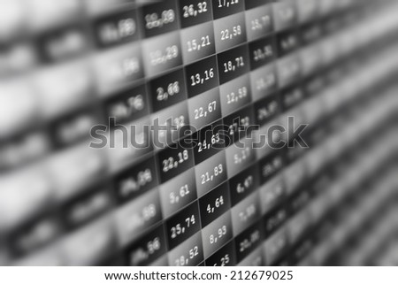 Stock market price digital display abstract. Modern virtual technology, photograph binary code on abstract technology background. Media gray and black image with graphs and icons. Shallow DOF effect - stock photo