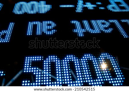 stock market price display with black background - stock photo