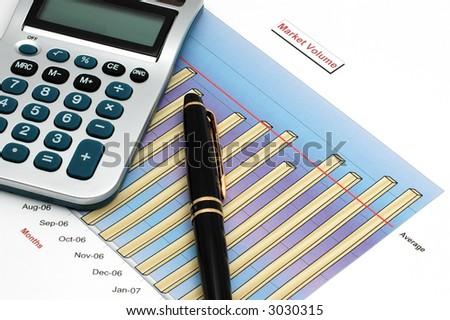 Stock Market Volume Bar Chart, Calculator and Pen - stock photo