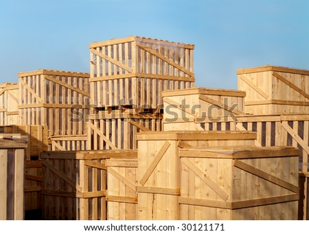 stock of heavy goods in wooden cases - stock photo