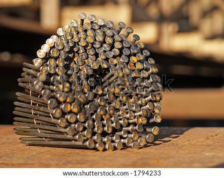Stock of nails for gun hammer, close-up - stock photo