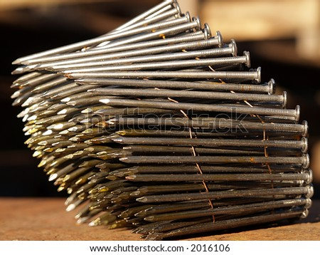 Stock of nails for gun hammer three, close-up - stock photo