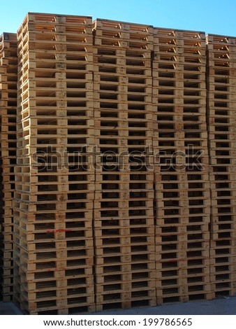 Stock of new wooden euro pallets stocked outside at transportation company, stored pallets  - stock photo