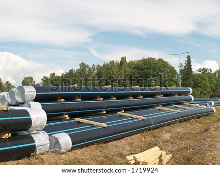 Stock of pipes ready to put into the ground - stock photo