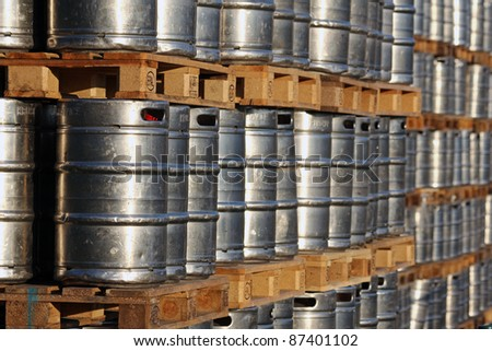 stock of steel kegs on the wooden palettes