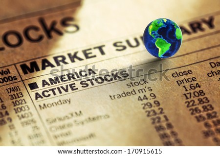 stock of the usa  market in the newspaper and globe. Elements of this image furnished by NASA