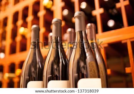 stock of wine bottles in cellar - stock photo