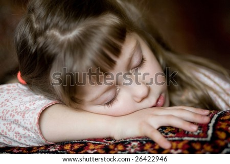 Stock photo: an image of a beautiful  girl on a sofa having sweet dreams